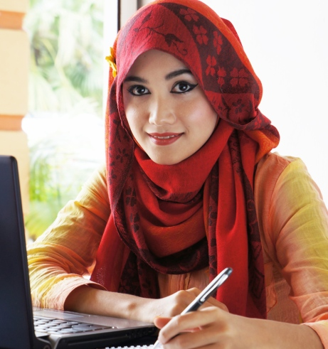 Beautiful muslim woman wearing red scarf ready to write